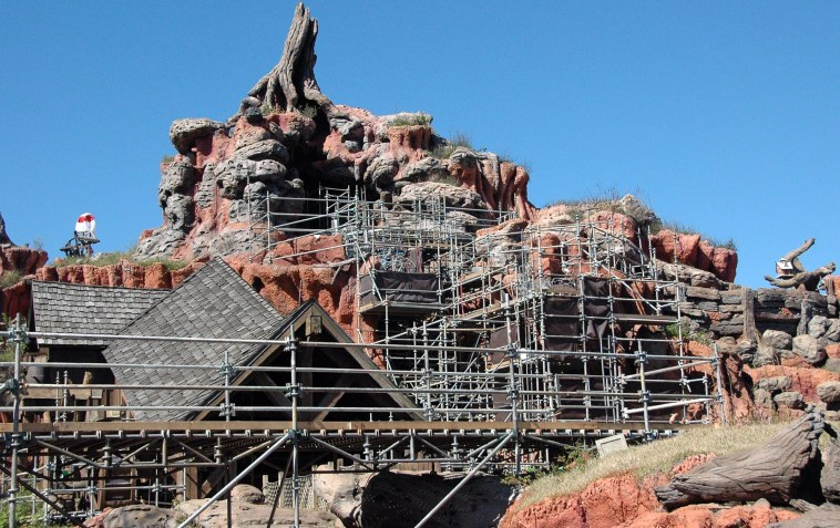 """When we went to the back of the Magic Kingdom to ride """"Splash Mountain"""" I caught this shot of the """"Big Thunder Mountain Railroad"""" in March 2014, we found some work being done on """"Big Thunder."""" It was a time of work and construction at Walt Disney World with the """"Seven Dwarfs Mine Train"""" and efforts such as at """"Big Thunder."""" Work always happens in the Disney parks, such as the renovations being completed now to the """"Tomorrowland Transit Authority PeopleMover"""" that will reopen in August 2014."""
