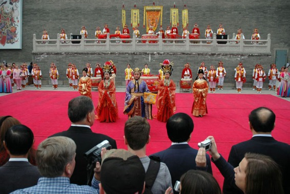 When the Barron Collier High School marching band went to China in 2007, I was a chaperone and our whole family made the trip to the other side of the Earth. Here's a shot I took during a ceremony at Xi'an, where we saw the famous Terra Cotta Warriors.