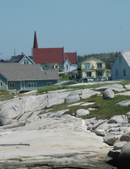 While visiting Peggy's Cove during one of our northern cruises (we fly into New York to catch a ballgame and a Broadway show and then head out on the cruise), I grabbed this shot in 2005. Here's a link to a ive webcam of the historic Peggy's Cove lighthouse. We've hit Halifax in Nova Scotia and St. John's in Newfoundland. During the Halifax stop we always travel to Peggy's Cove to walk on the rocks and see the lighthouse.