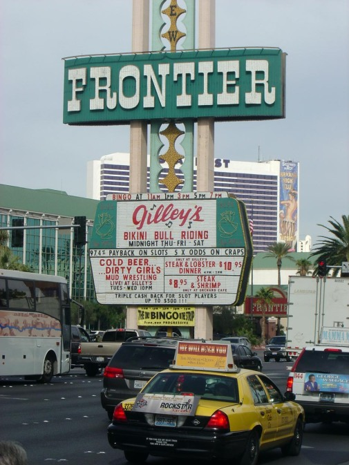 I grabbed this shot of the sign at the Frontier Hotel and Casino while we were in Las Vegas in the summer of 2005. The Frontier, which was the second hotel to open on the famed Las Vegas Strip, has since been razed (it came down in 2007. According to reports, construction on a new Frontier will begin in 2015. The marquee phrases are typical Las Vegas.