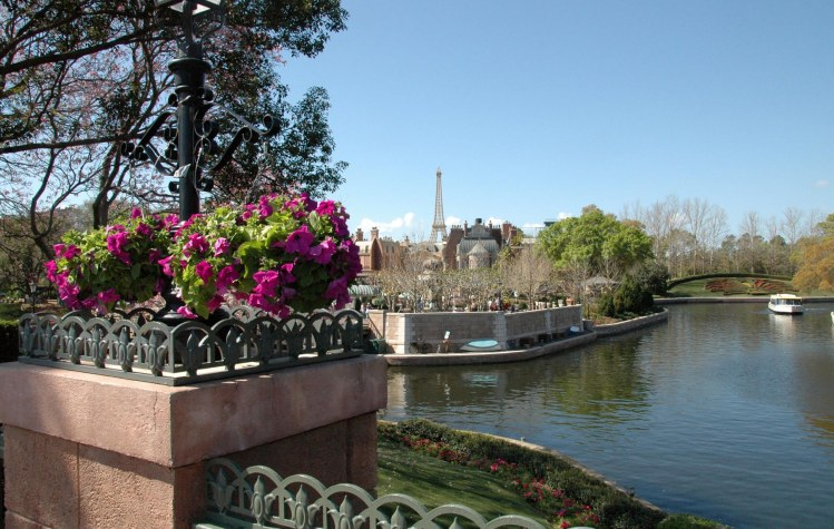 Here's a view in EPCOT with the replica Eifel Tower at the France pavilion in the background. The view, which I shot in March 2014, shows flowers in bloom along the central lake at the World Showcase at Walt Disney World.