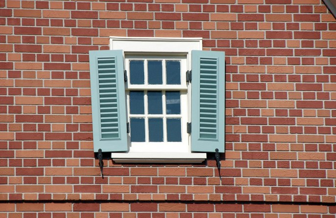 If you closely in the Liberty Square area of the Magic Kingdom, you'll notice shutters are askew. It is because during the Revolutionary War metal was in short supply and such material as hinges were taken down and melted to become ammunition. Shutters were then secured with leather. I grabbed this shot when we were at Walt Disney World in August 2014.