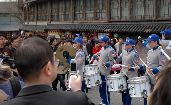 The Barron Collier High School Band (Naples, Fla.) played U.S. patriotic music at the Great Wall when it visited China in 2007 and traveled to Beijing and Xi'an. It was a sensational moment and Chinese in the area where the band played gave us a warm reception. Here you can see an onlooker taking a photo of the band's drumline as it warmed up for the audience that quickly gathered.