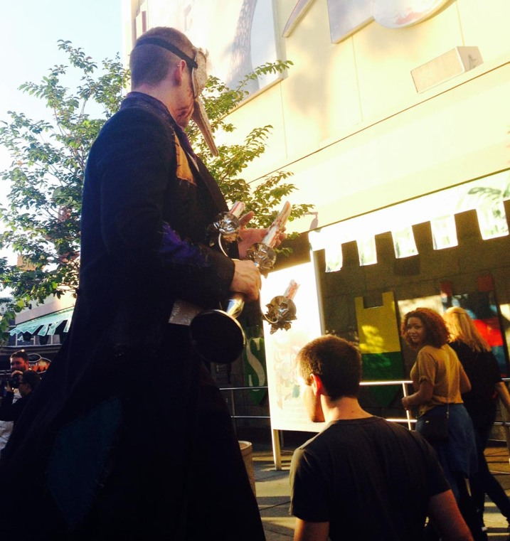 """Remember """"victims,"""" NEVER turn your back on anyone at the Halloween Horror Nights 24 at Universal Studios Orlando. Cast members use """"scare zones"""" and haunted houses to scare guests as well as creeping around behind them. This character is walking on stilts."""