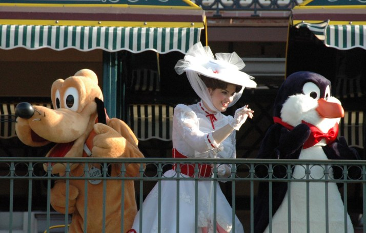 Characters arrive by train and greet waiting guests each morning at the Welcome Show to open the Magic Kingdom at Walt Disney World. I got this shot when we were visiting in August 2014. Disney characters including Mickey and Minnie arrive on the Walt Disney World Railroad.
