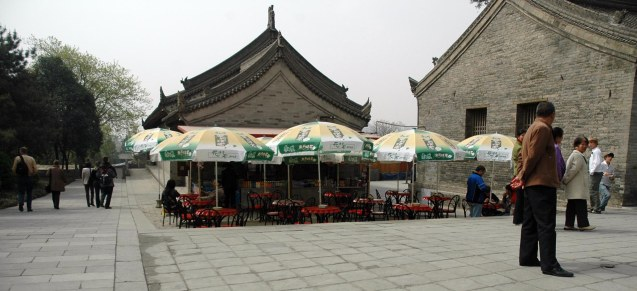 Here's a look at an outdoor café in China – but note how the umbrellas give it that more cosmopolitan touch than the classic architecture would normally reflect. We visited Beijing and Xi'an in 2007.