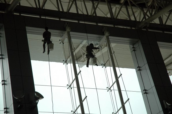 Yes, you can see mundane jobs when you visit China. Here's a shot I got of window washers at the airport in Xi'an. Our whole family was on the trip 2007 trip by the Barron Collier High School marching band (I was a chaperone).