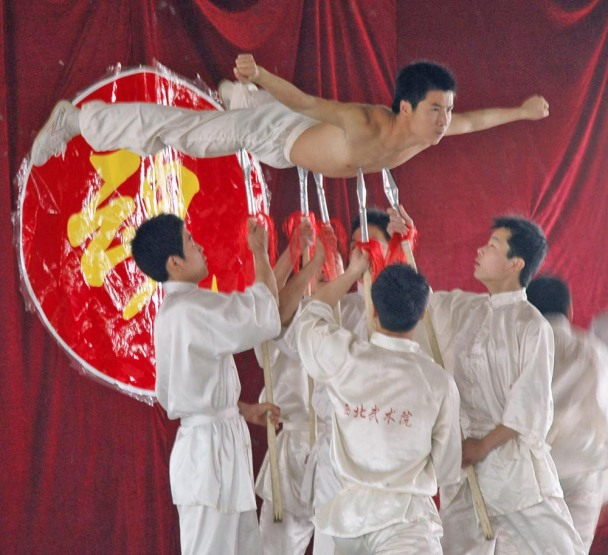 Here's a shot of a demonstration at a martial arts academy in Xi'an when we visited China in 2007. In this shot, the man is being held up on the points of weapons. The members of the academy ranged in age from young children to teenagers.