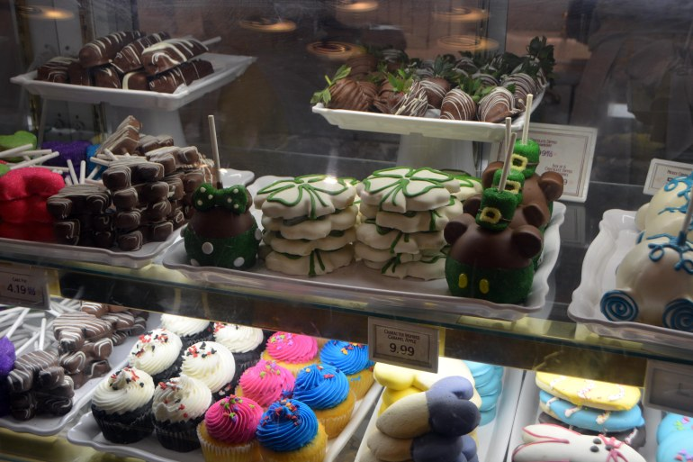 While making an overnight Spring Break trip to see the EPCOT International Flower & Garden Festival, Allison and Debbie were at Disney's Hollywood Studios on St. Patrick's Day (March 17, 2015) and Allison got this shot of goodies at a pastry shop (note the $9.95 price of a caramel-chocolate covered apple) during the visit to Walt Disney World.
