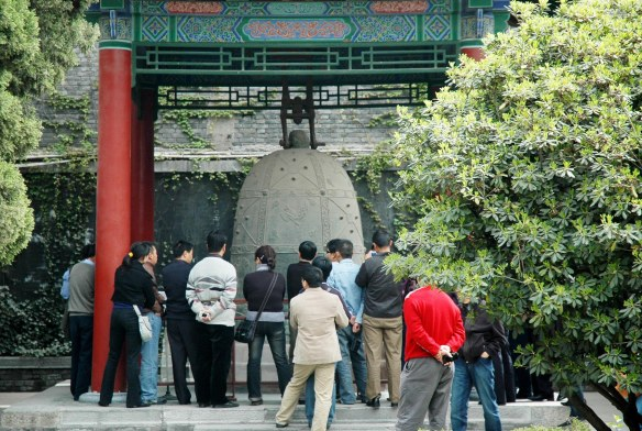 Here are some tourists examining an artifact at a historical site in Xi'an in China during our visit in 2007.