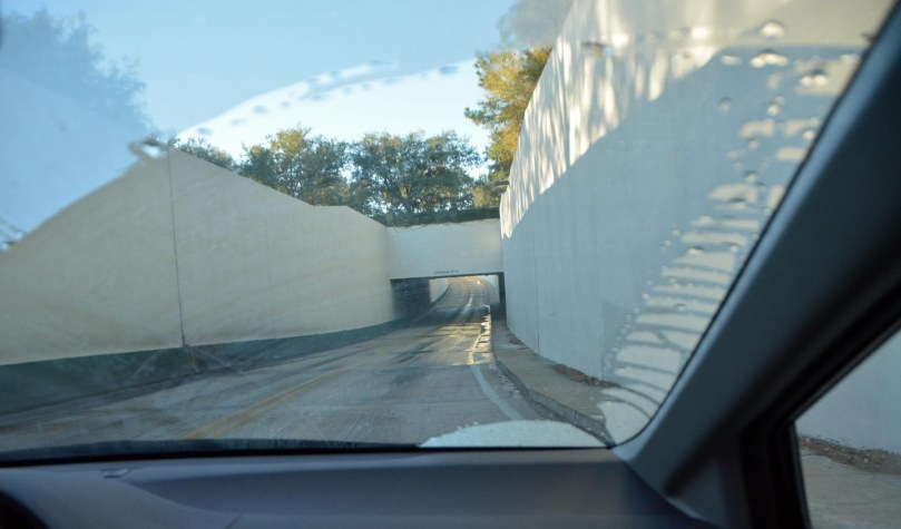 We were out early for a rare drive on the morning of Feb. 8, 2015, when I got this shot of a tunnel at Walt Disney World. You can see the morning condensation on the windshield as I rode shotgun. Some of the tunnels have a waterway overhead (such as one near the Contemporary Resort and entrance to the Magic Kingdom). This one, which is near the Yacht Club and Beach Club resorts has … well, I don't know. A road? Water? Your gues is as good as mine.