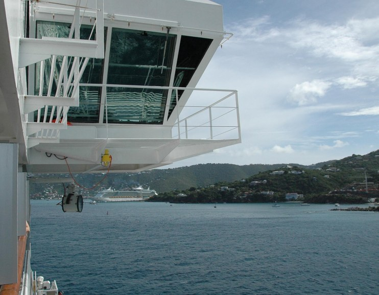 I should have chosen a better time to shoot a reflection off our cruise ship's bridge rear window in 2008. You can see a reflection of a railing or something in the glass, but a different shot at a different time of day might have brought a better one.