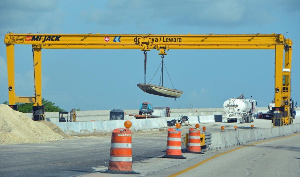 How do to protect a boat from a thief? Hang it up in the air, of course! I got this shot June 27, 2015, on Interstate 75 in North Fort Myers, Fla. Workers on the Southwest Florida bridge project were protecting their small boat over the weekend.