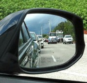 A driver's right-side mirror isn't always filled with moving traffic. Here's a shot I got on my iPhone on Aug. 17, 2015, in Naples, Fla., after passing a three-car crash on Airport-Pulling Road, just south of Pine Ridge Road. I was on my way home from work and was stopped at the traffic signal when I got the shot.