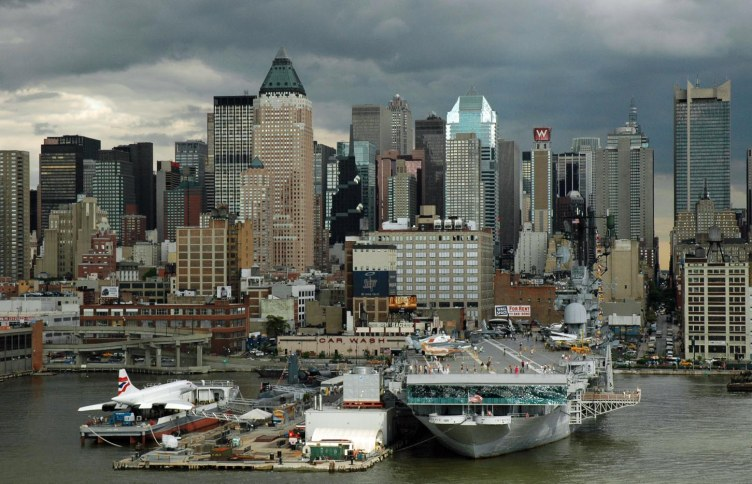 I got this shot in 2005 as our Carnival cruise ship left New York City bound for Canada. It was a cloudy send-off as the ship passed the Intrepid Sea, Air & Space Museum Complex (you can see the stern of the aircraft carrier).