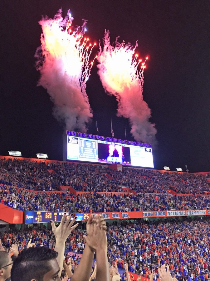 "Well, I posted a photo of the ""lucky cup"" Allison gave me for the 2015 football season. She's at the University of Florida and rooting for the Gators. Last night (Saturday, Oct. 3, 2015), the Gators won the biggest game under new coach Jim McElwain. Allison got this shot of fireworks that were set off after the Gators' final touchdown (the scoreboard says 37-3 because UF had not kicked the extra point when she got the shot). We completely pounded the THIRD RANKED University of Mississippi (or Ole Pi$$ as we say in trash talk) by a score of 38-10. Click here to view my ""lucky cup"" and you can also click here for all my Gators photos."