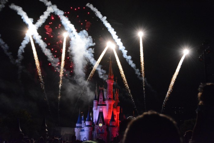 Allison experimented with our Nikon's shutter speeds and other settings in getting shots of a fireworks show when she was at Walt Disney World on Friday, Oct. 16, 2015, during Mickey's Not-So-Scary Halloween Party at the Magic Kingdom. This one looks like the three fireworks on the right came out of the top of the spectator's head.