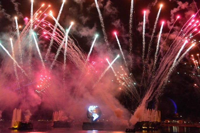 Allison continues to get great fireworks shots at Walt Disney World. She got this shot at IllumiNations: Reflections of Earth on Dec. 16, 2015, while she and Debbie were at EPCOT. Look close: in the bottom right, you'll see a sliver of blue light on Spaceship Earth that looks like a partial moon.