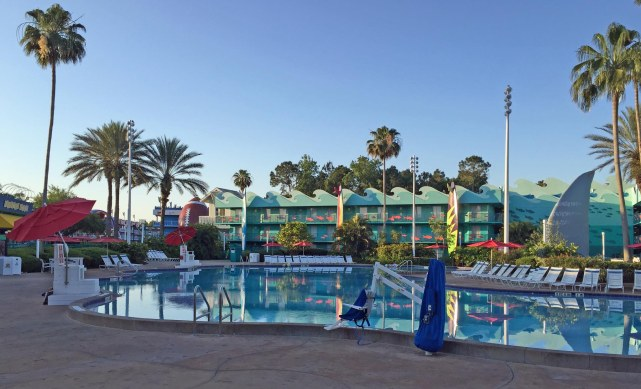 """It was a peaceful and very calm morning on May 8, 2016, as Debbie and I walked to the food court from our room at Disney's All-Star Sports Resort. The pool was an excellent example of """"smooth as glass"""" (it was early in the morning and it wasn't open yet) and there wasn't a single cloud in the sky. We visited Walt Disney World on a weekend for the EPCOT International Flower & Garden Festival."""
