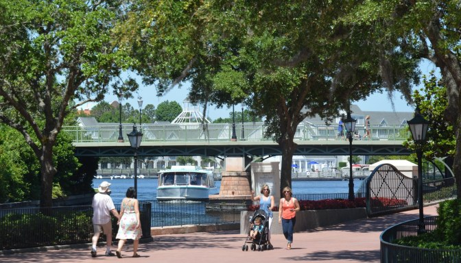 You can see the transportation boat headed under a bridge as it heads to debarkation at EPCOT. The bridge above it leads to Disney's BoardWalk (left from this view) from Disney's Yacht Club and Beach Club resorts. I got this shot on May 7, 2016, as we walked back to the Yacht Club after enjoying the EPCOT International Flower & Garden Festival. We were at Walt Disney World for a weekend visit.