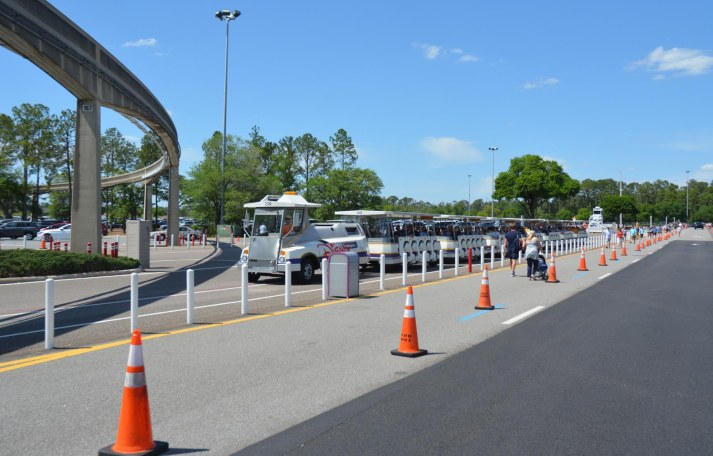 If you get to some parks at Walt Disney World early, you don't always take a tram. Here's a line of folks walking back to their vehicles as a tram heads to drop off guests at EPCOT. We were at Walt Disney World on April 10, 2016, for this past season's EPCOT International Flower & Garden Festival when I got the shot.