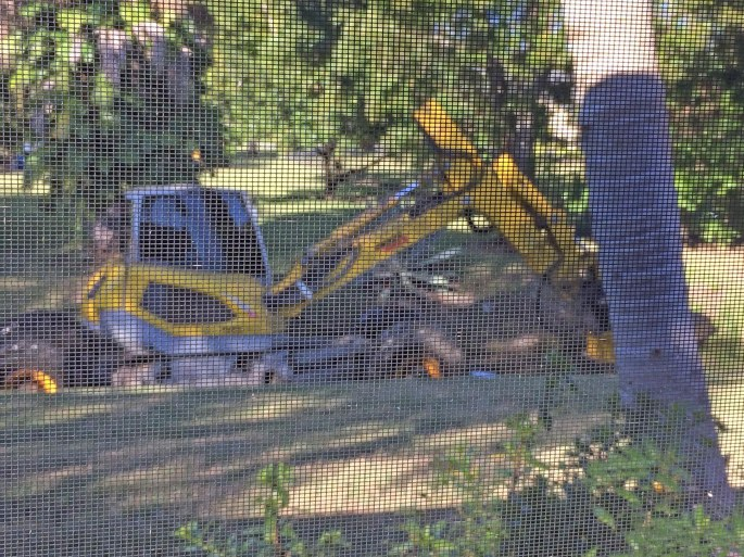 Here's an example of the point of focus with a camera. Yesterday I posted two photos of this drainage ditch cleaning machine. Debbie got photos of the machine on her iPhone. Today's photo has a field of focus that caught on the screen of our pool cage. Interesting photo! The photos were taken Nov. 22, 2016, at the back of our home in Naples, Fla. The machine makes its slow trek along the storm water drainage ditch every couple of years.
