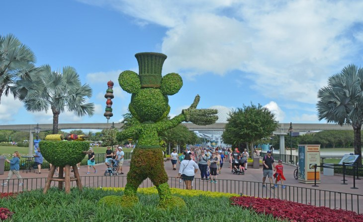 This Mickey Mouse topiary is holding a shish-kebob as it greets guests to the Epcot International Food & Wine Festival on Oct. 1, 2016, at EPCOT. The topiary was at the entrance to World Showcase and we were on a day trip to enjoy the festival at Walt Disney World.