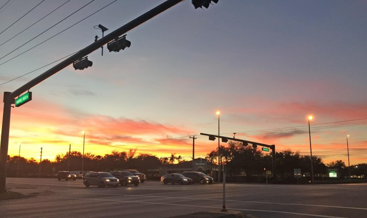 It might have gotten cold overnight for us here in Southwest Florida on this morning of Dec. 31, 2016, so I guess this wonderful red sky at morning on Dec. 30, 2016, was a precursor to the cold snap. I got this shot on my way to work in Naples, Fla.