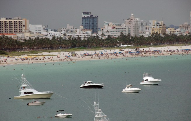 Here's a shot showing boats at anchor off Miami's famous South Beach. There was a gray sky that day with storms coming in the west when I got this shot from our Carnival cruise ship coming out of Government Cut and into the Atlantic in June 2010.