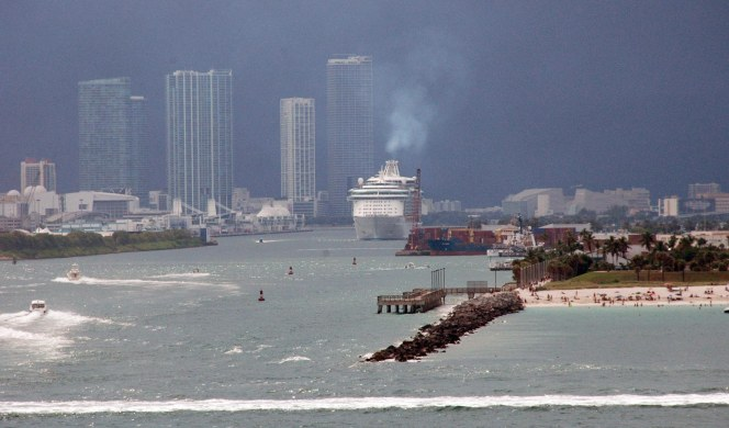 It was a dark sky behind the ship that followed our Carnival cruise ship out of Government Cut and into the Atlantic in June 2010. I grabbed this shot as we were going out of the Port of Miami. BTW, the white line at the bottom of the photo is the wake of a boat having crossed the sea behind us.
