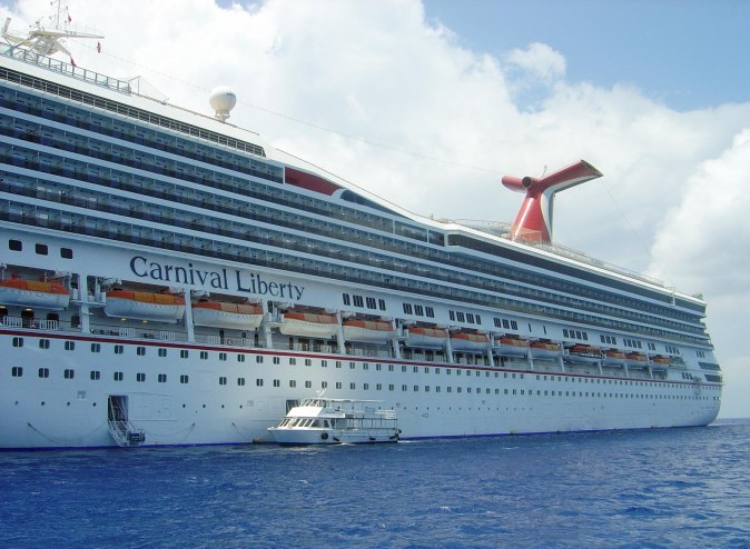 Here's a shot from 2010 from our cruise the western Caribbean. It shows a shuttle boat – sometimes called a tender – beside our cruise ship, the Carnival Liberty.