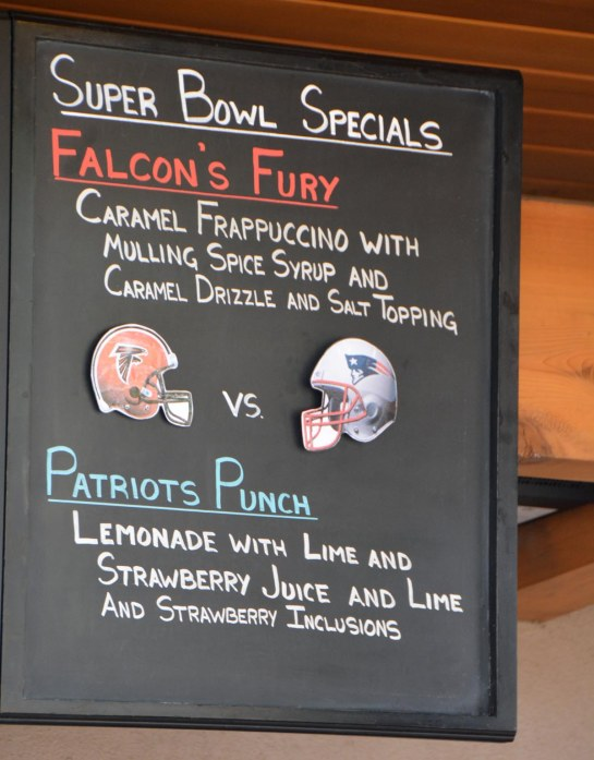 "Today is Super Sunday (Feb. 5, 2017). We're at Walt Disney World this weekend and you could find the football spirit at Starbucks at Disney Springs with this Super Bowl offering of ""Falcon's Fury"" and ""Patriots Punch."" The one honoring the team from Atlanta is a caramel frappuccino, while the punch is lemonade with lime and strawberry juice. I got the shot on Feb. 4, 2017, before we went to lunch."