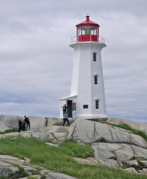 Today I'll post yet another photo of the trademark lighthouse at Peggy's Cove in Canada. We've done a northern cruise several times by flying into New York (ballgame and a Broadway show) and then a cruise to Canada. We've hit Halifax in Nova Scotia and St. John's in Newfoundland. During the Halifax stop we always travel to Peggy's Cove to walk on the rocks and see the lighthouse. I'm unsure of which year's cruise we were on when I got this shot.