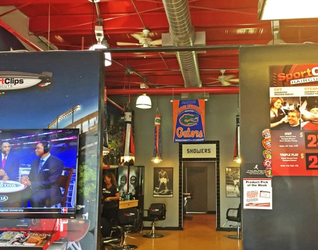 "Go Gators! It's always nice to walk into an unfamiliar business and see your alma mater's banner! I got this shot on Feb. 19, 2017, during my first visit to SportsClips here in Naples, Fla. I tried them out after completely poor service at a nearby shop that believes its cuts are ""super."""