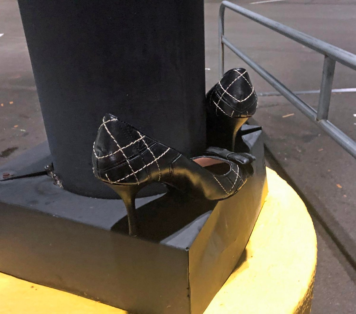 Why Leave These Shoes On A Walmart Parking Lot Light Post
